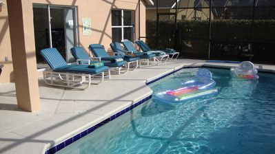 Sunny pool deck with loungers