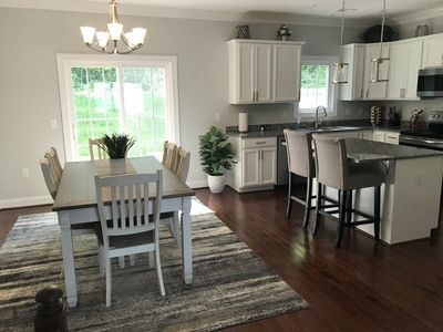 Eat in kitchen with seating for six people.  Patio doors to patio.