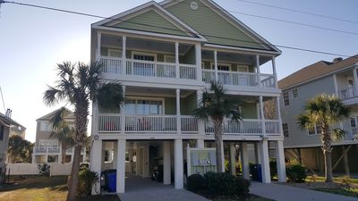 Photo for Beautiful Surfside Beach house, steps to the beach.  Pool, golf cart , linens .