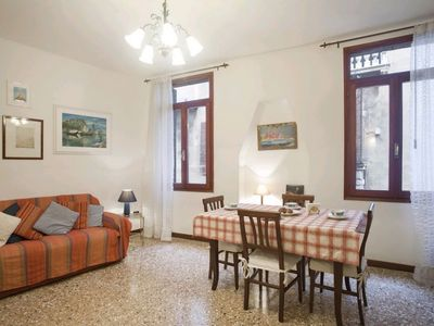 Photo for Sant'Agostino: comfortable bright apartment with a view vue on a canal