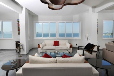 Part of the living room, facing the ocean and the beach