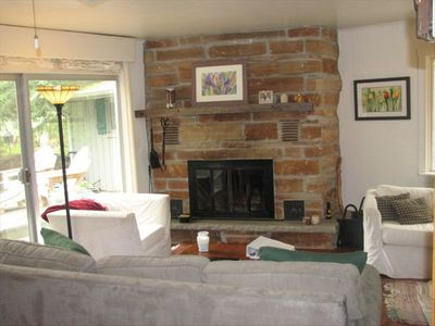 Fieldstone fireplace and comfortable seating in Great Room (also shows sofa bed)