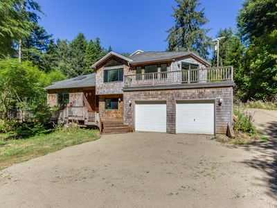 Photo for Luxury riverfront home w/ several acres, a hot tub & swimming holes - dogs OK!