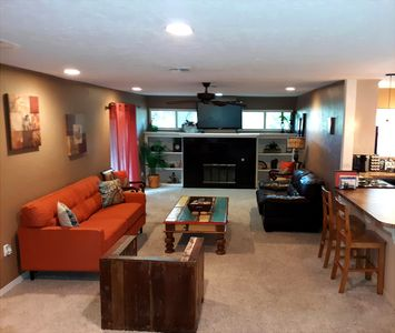 Living room with lots of seating for family and guests!