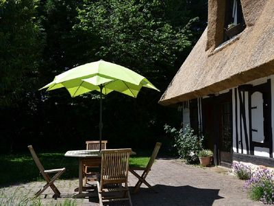 Photo for Authentic thatched cottage on enclosed garden, baby equipped, between Honfleur and Rouen