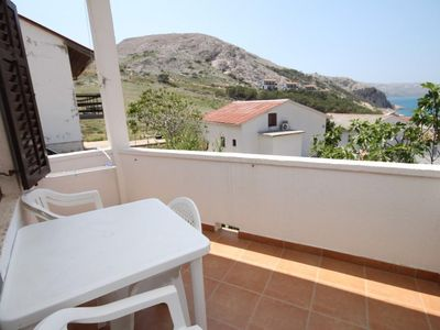 Photo for One bedroom apartment with terrace and sea view Metajna (Pag) (A-6337-c)