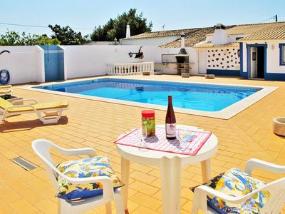 Photo for This 4-bedroom villa for up to 8 guests is located in Paderne (South) and has a private swimming poo