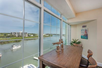 Complete with waterfront barstools, watch dolphin below and enjoy