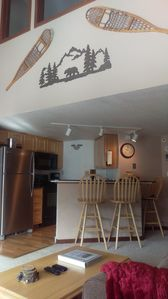 Kitchen area with granite and stainless steel appliances