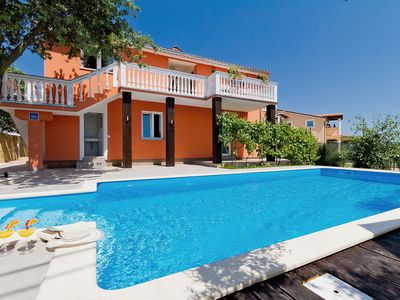 Photo for This 5-bedroom villa for up to 14 guests is located in Pula and has a private swimming pool, air-con