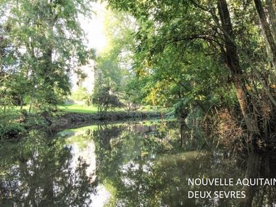 Photo for CHARMING HOUSE10 / 12 PERS-EDGE OF RIVER IN GREEN CASE