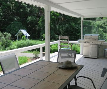 On the back porch with grill and seating for 9. Entry access into the cottage.