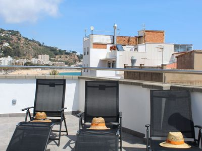Photo for Chill out terrace infront of the beach. 9 bedrooms with wifi.