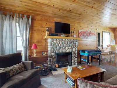 Photo for Charming, warm cabin w/ huge backyard and private hot tub!