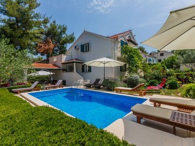 Photo for Big family villa with pool, quiet & green location, just 2 minutes walk to beach