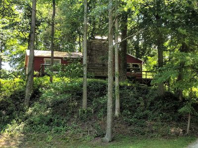 Our creekside cabin is nestled deep in the country on a secluded lane.