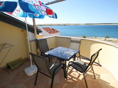 Photo for Two bedroom apartment with terrace and sea view Povljana, Pag (A-3316-g)
