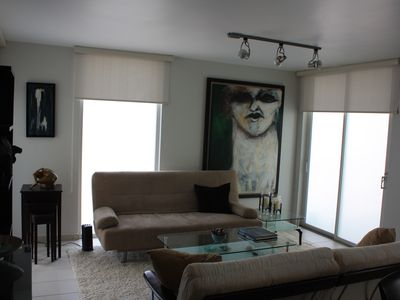 Tastefully decorated living area with original artwork and natural lighting.