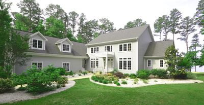 6,500 sq ft custom-built home w/ beautiful gardens and 6 acres of forest trees.