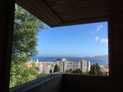 Photo for Wooden house sea view 9 places, 100m from the port and sailing school