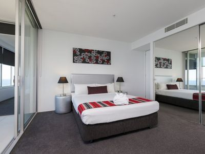 Photo for Deluxe Three Bedroom Sub Penthouse Apartment with Spa Bath Level 60+ at Q1