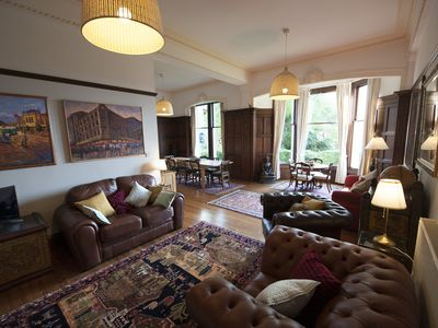 Photo for A huge, light, 2 bedroom ground-floor flat, with hill views & private garden