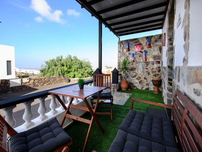 Photo for Lovely Apartment with Spacious Porch, Ocean and Mountain Views & Wi-Fi; Street Parking Available