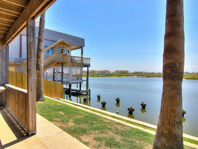 Photo for Waterfront condo with shared pool and boat dock only moments away from the beach