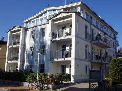 Photo for Apartment Schloonblick, central, 300 m beach, free Wi-Fi, gas fireplace, 2 balconies