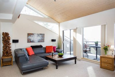 Bright, open, warm living room with an amazing view of Park City's Round Valley