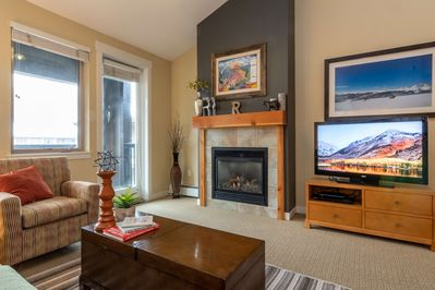 Cozy living room with flat screen TV and fireplace