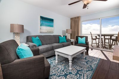 Come unwind in this stunning contemporary space by the sea - Can't beat these upgraded amenities followed by these incredible Gulf views.