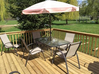 Enjoy 4 acres of park-like setting from the deck