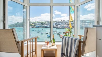 Photo for Two Harbour House, right on the Wharf seafront of St Ives overlooking the harbour and beach. Allocated parking in garage. Free WiFi.