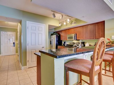 Photo for Perfect for families, this beachfront unit sleeps 8.  Close to outlets, dining.
