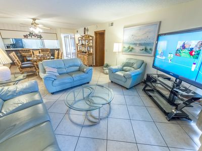 Photo for Ground Floor at Sandcastles - Large heated pool & hot tub - Directly on the Beach