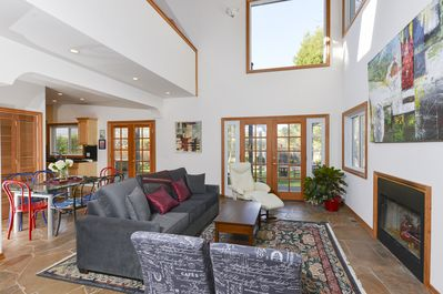 Living Room - Glass doors lead to the secluded backyard.