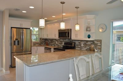 Renovated Kitchen: granite counters, stainless appliances, & solid wood cabinets