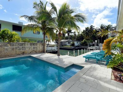 Photo for 4BR waterfront home with POOL, boat slip with straight shot to Alligator Reef!