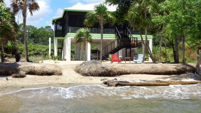 Photo for SUN and SEA BEACH HOUSE nestled on its own private beach on the Caribbean Sea!