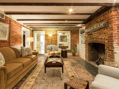 Living Room with exposed beams and exposed brick walls and large Flat Screen TV