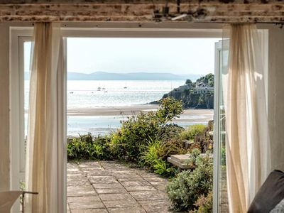 Photo for In a fabulous waterside location with mesmerising sea views, the superb coastal location is echoed t