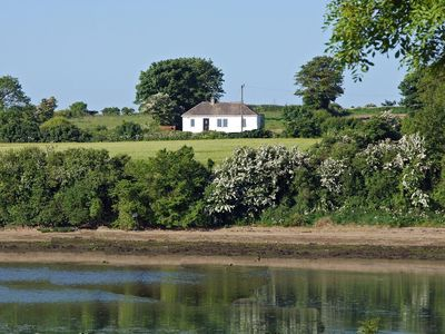 Photo for Detached cottage in superb location in cul-de-sac and beside tidal estuary, with far reaching…