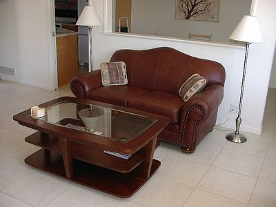 Leather couch and big coffee table.