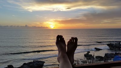 Take your flip flops off and enjoy the gorgeous sunrise with a cup of coffee WOW