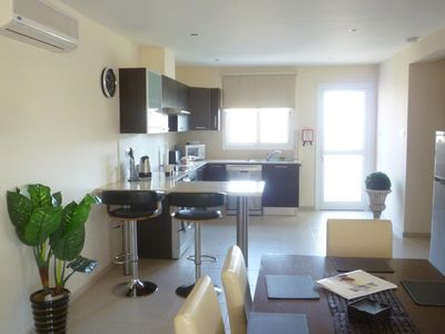 Photo for LUXURIOUS 2 BED PENTHOUSE APARTMENT with LARGE PATIO, COMMUNAL POOL, WI-FI.