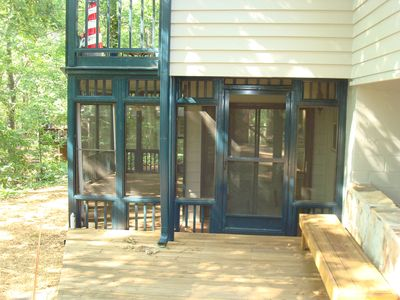 view of lower level deck of screen porch