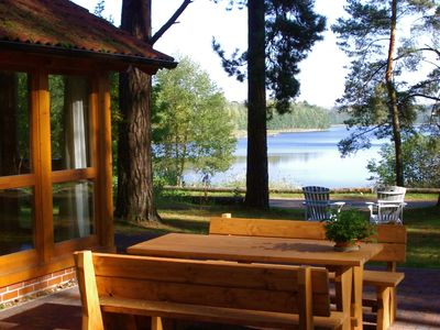 Photo for Your beautiful lake house with fireplace, sauna and spectacular lake views! With electric charging station