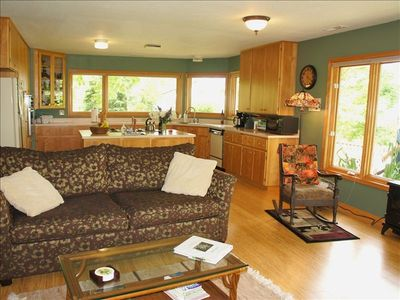 Bright, open floor plan of kitchen and living room.