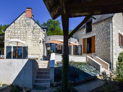 Photo for Beautiful restored house with heated infinity swimming pool, in the Loire Valley